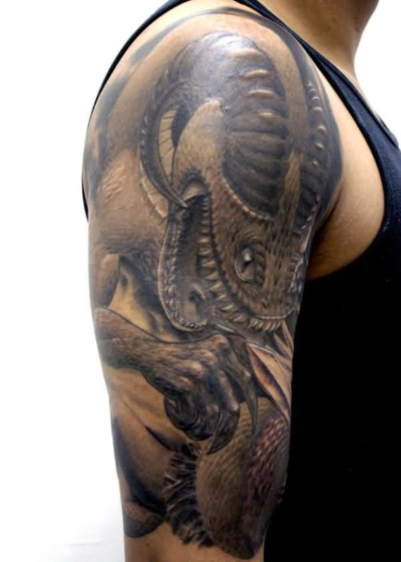 33d8c1439 Handsome Cool Men Show Fantastic Scary Demon Tattoo On Upper Sleeve