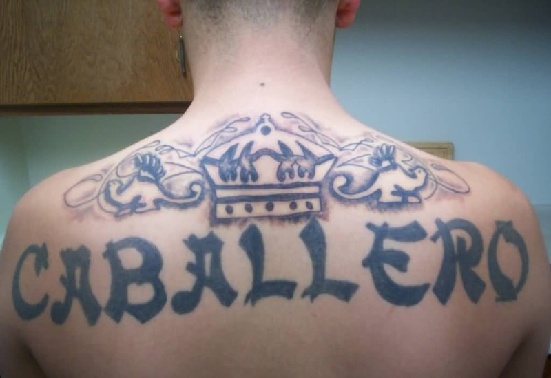 Handsome Cool Men Show Outstanding Caballero Text And Simple Old Crown Tattoo On Upper Back