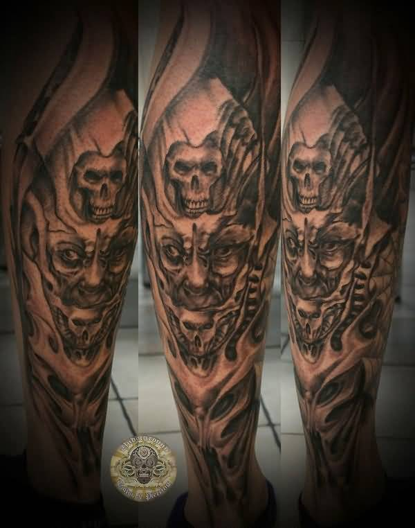 8800c7df0 Handsome Cool Men Show Outstanding Small Skull And Scary Demon Face Tattoo  On Leg