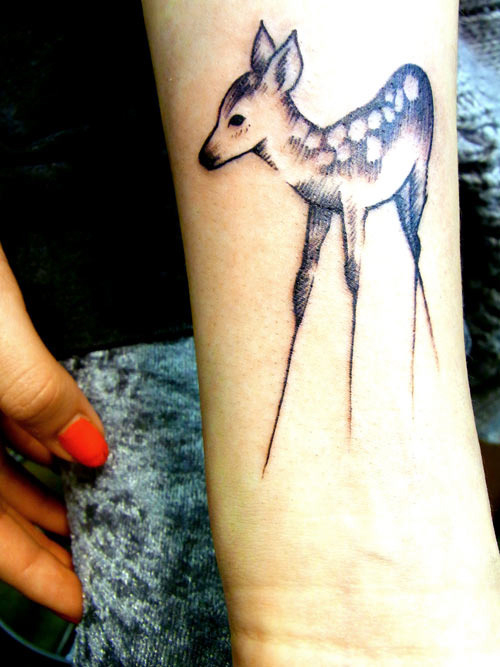 Hot Stylish Young Women Show Innovative Deer Tattoo Design Make On Lower Sleeve