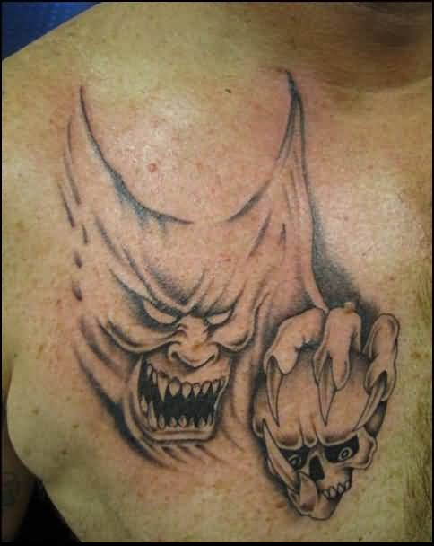 Men Chest Cover Up With Outstanding Angry Demon Hold Skull Face Tattoo