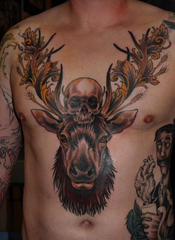 Men Chest Decorated With Simple Skull And Big Deer Face Tattoo