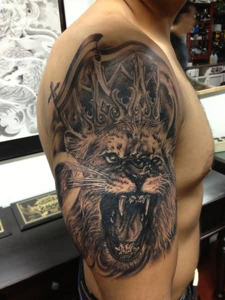 Men Upper Sleeve Decorated With Brilliant Angry Lion And Crown Tattoo