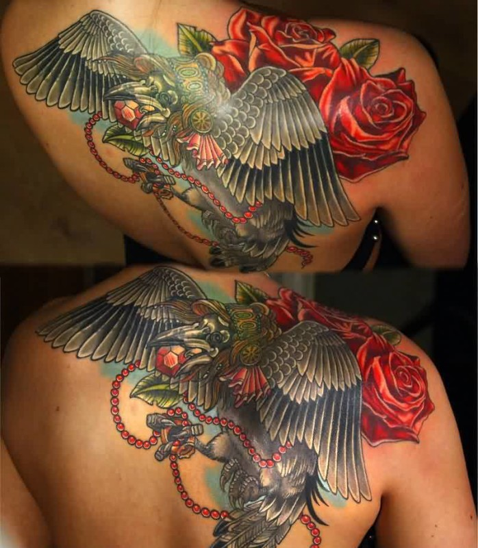 Nice Looking Flying Crow And Lovely Red Flowers With Chain Tattoo On Upper Back