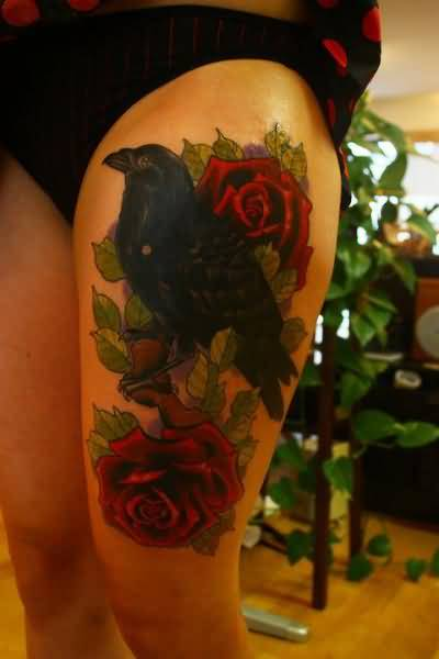 Outstanding Black Crow And Beautiful Red Roses Tattoo On Thigh