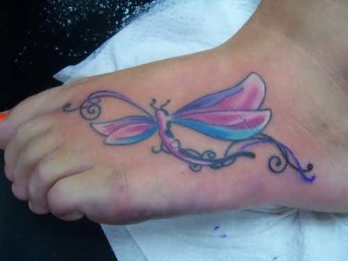 Outstanding Classy Dragonfly Tattoo On Women's Foot