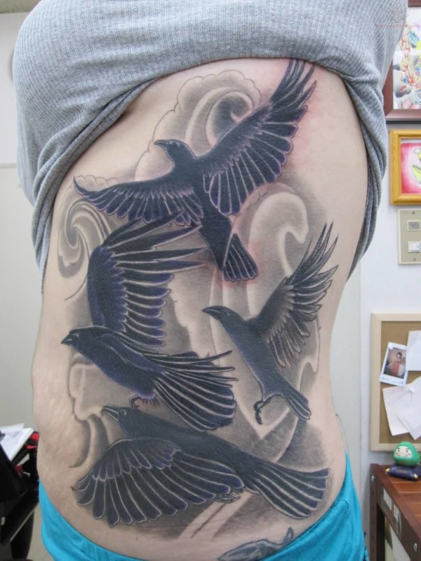 Pretty Hot Women Show Outstanding Flying Crows Tattoo On Rib Side