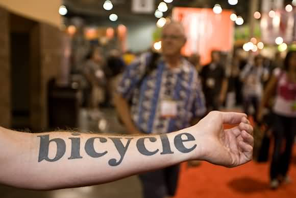 Simple Black Ink Bicycle Text Tattoo Design For Lower Sleeve