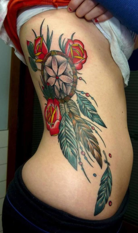 Simple Feather And Red Flower Dream Catcher Tattoo On Rib Side