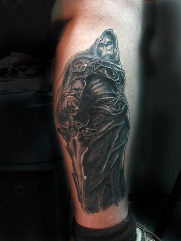Stylish Men Show Wonderful Black Ink Scary Death Grim Hold Sword Tattoo On Leg