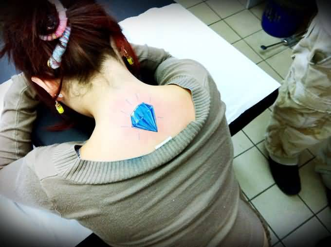 Terrific Blue Diamonds Tattoo Design Make On Women's Upper Back