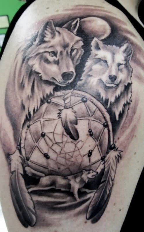 Ultimate Wolf And Traditional Old Dream Catcher  Tattoo On Upper Sleeve
