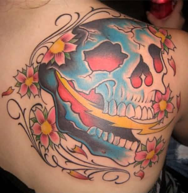 Upper Side Back Decorated With Ultimate Angry Open Mouth Dia De Los Muertos Skull And Lovely Pink Flower Tattoo