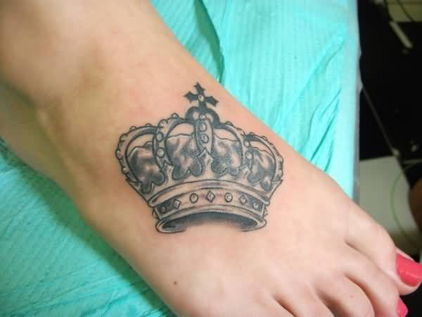 Women Foot Cover Up With Brilliant Crown Tattoo Design Made By Expert
