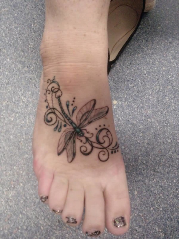 Women Show Outstanding Classy Dragonfly Tattoo On Foot