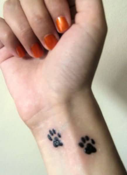 Women Wrist Decorated With Nice Looking Dog Paw Tattoo