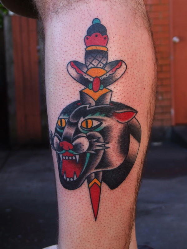 Wonderful Angry Panther And Wonderful Dagger Tattoo Design