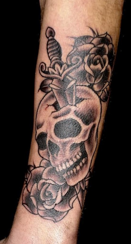 Wonderful Angry Skull And Dagger Tattoo Design