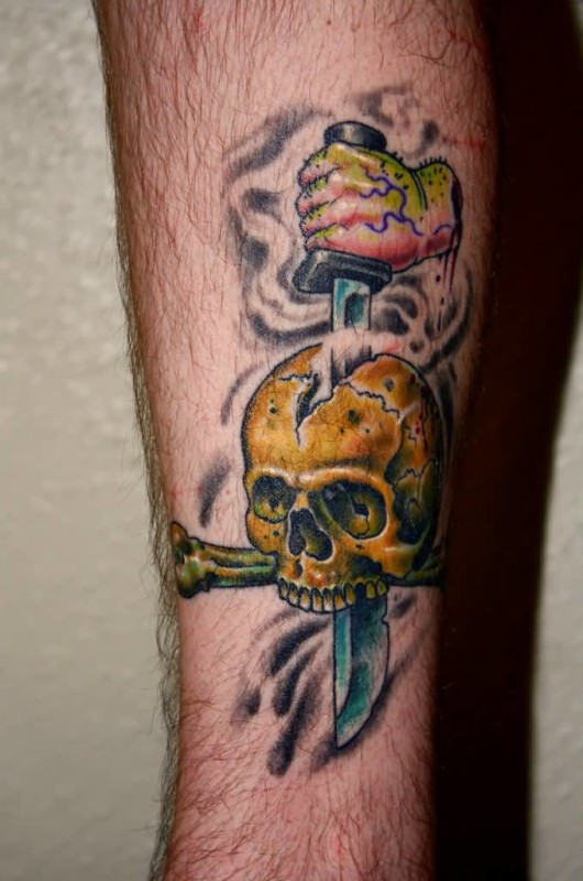 Wonderful Yellow Skull And Dagger Tattoo Design For Handsome Cool Men