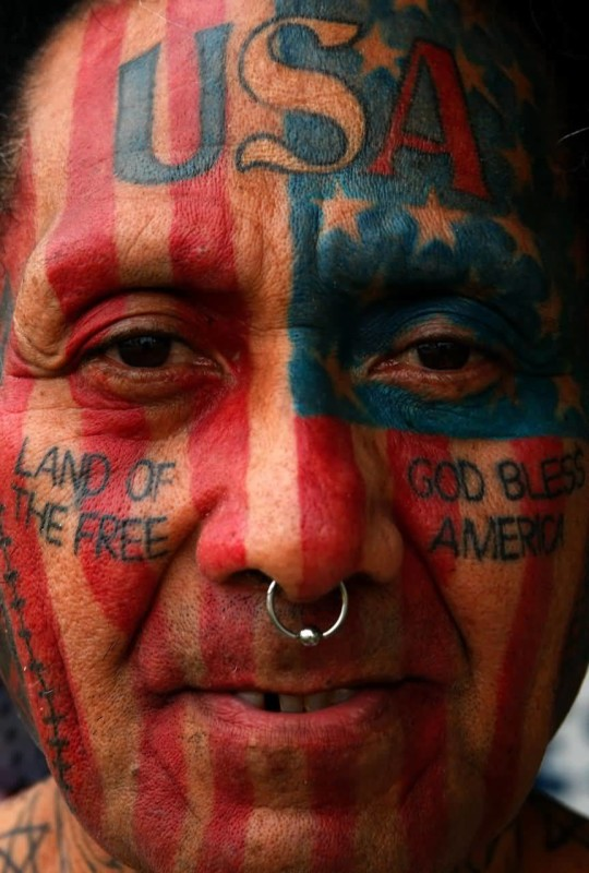 Amazing American Tattoo On Men's Face