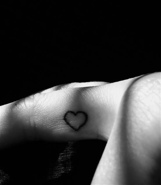 Amazing Small Simple Black Lovely Heart Tattoo On finger