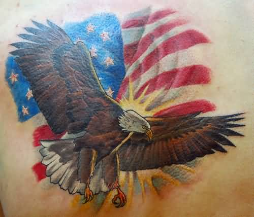 Angry Flying Eagle With Brilliant American Flag Tattoo Design