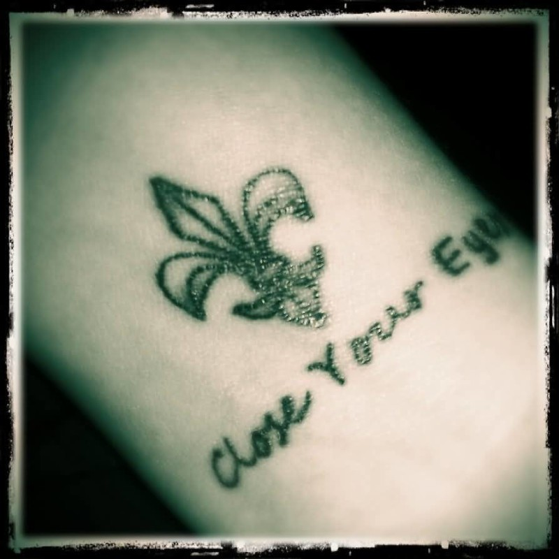 Attractive Wording And Small Fleur De Lis Tattoo