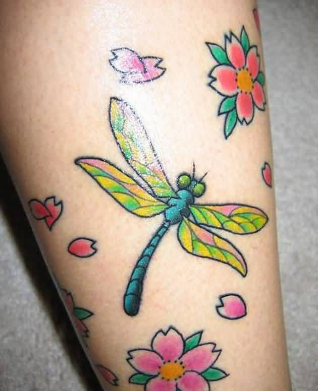 Awesome Flowers And Flying Crazy Dragonfly Tattoo