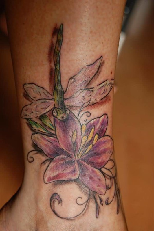 Fabulous Flower And Amazing Dragonfly Tattoo Make On Leg