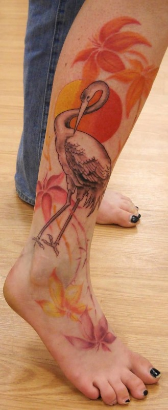 Famous Duck And Colorful Feminine  Flowers Tattoo Image On Women's Leg To Foot