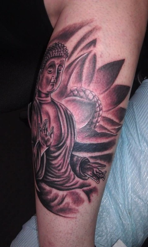 Famous Religious Buddha Ansd Flower Tattoo Make On Elbow