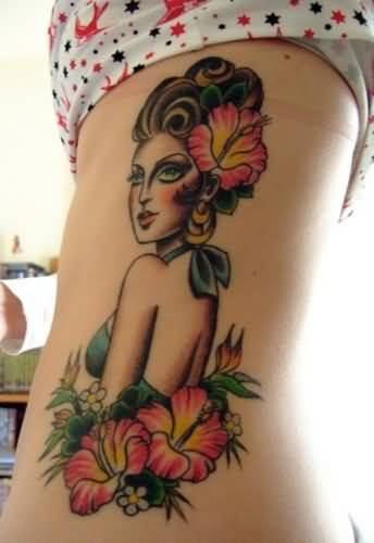 Fantastic Cool Girl Face And Nice Flower Tattoo On Women's Rib Side