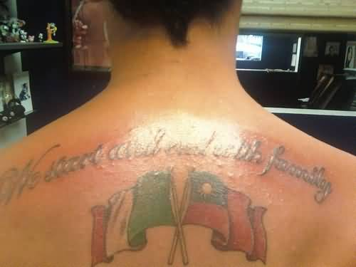 Fantastic Cross Flags With Nice Wording Tattoo On Men's Upper Back