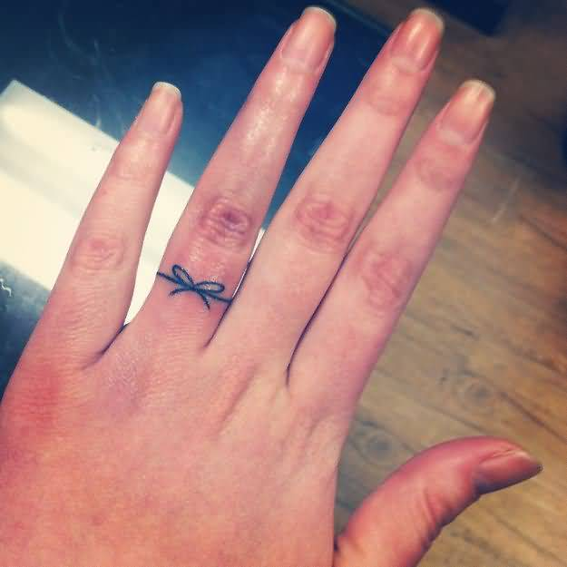 Fantastic Ring Finger Amazing Bow Tattoo Design For Pretty Hot Women