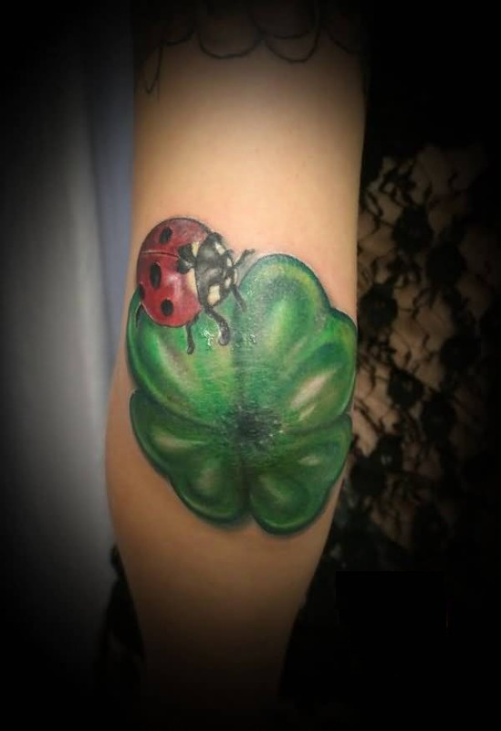 Fantastic Green Clover And Crazy Lady Bug Tattoo On Elbow For Women