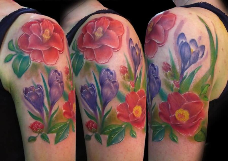 Great Looking Flower Tattoo Made By Colorful Ink On Upper Sleeve