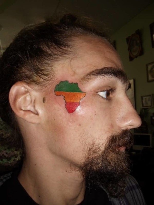 Handsome Cool Men Show Fantastic Colorful African Map Tattoo On Side Face