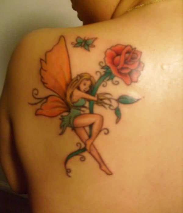 Lovely Orange Wings Fairy Hold Lovely Flower Tattoo Make On Upper Back For Women