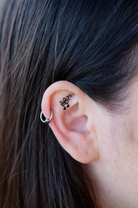 Mind Blowing Black Music Notes  Tattoo Design Make On Women's Earlobe