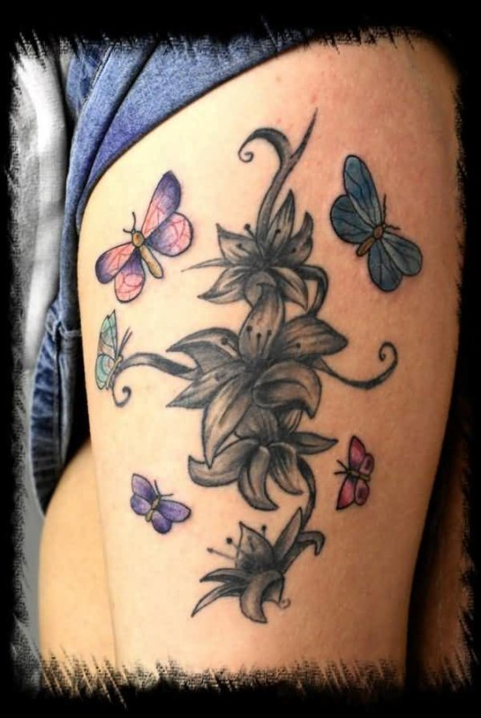Nice Flying Butterfly And Flower Tattoo Design Image Make On Women's Thigh