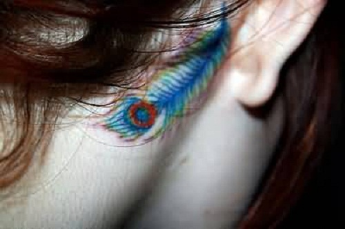 Nice Looking Colorful Peacock Tattoo Design Make On Behind Ear For Women
