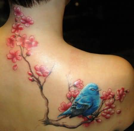 Nice Looking Flower With Tree And Bird Upper Back Tattoo