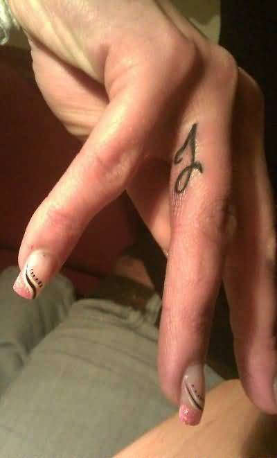 Nice Ring Finger Women Tattoo Design Image