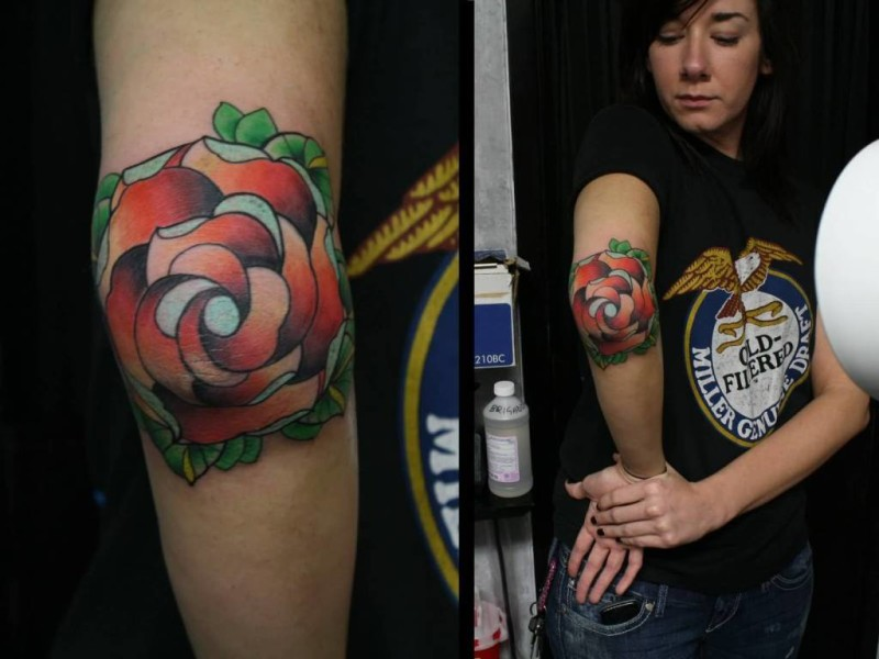 Pretty Hot Women Show Fabulous Rose Flower Tattoo On Elbow
