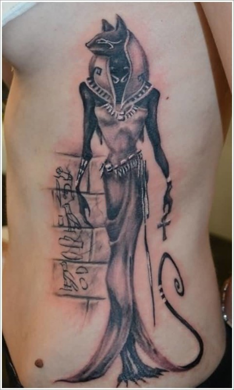 Pretty Hot Women Show Wonderful Egyptian Cat Tattoo On Rib Side
