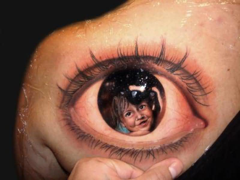 Realistic 3D Baby Face In Eye Tattoo Design Make On Upper Side Back For Women