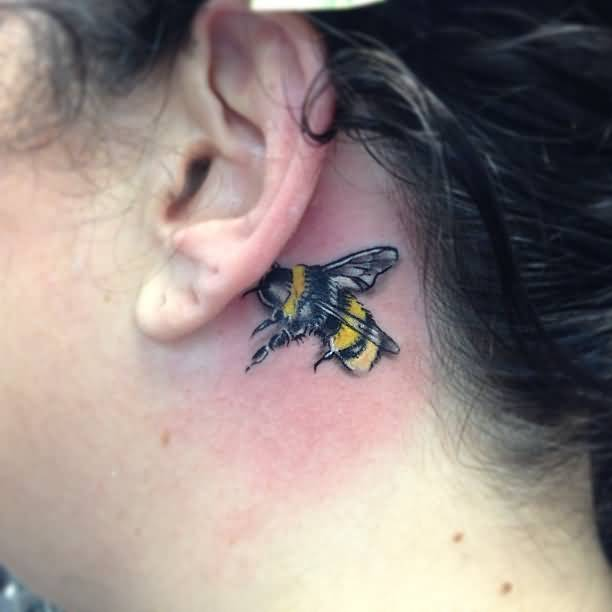 Realistic Behind Ear Tattoo Of Ultimate Colorful Bee For Women