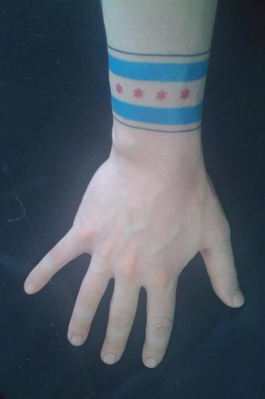 Simple Flag Tattoo Design For Men On Wrist