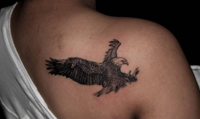 Simple weird eagle tattoo make on upper side back for Side back tattoo