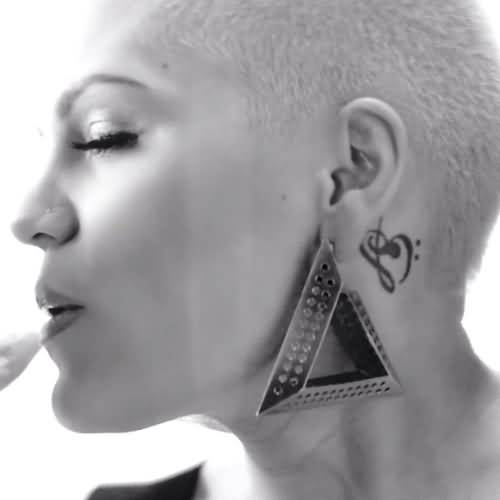 Stylish Women Show Amazing Black Ink Famous Music Note Tattoo On Behind Ear